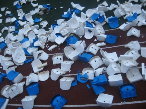Plastic chairs on the stadion broken by soccer hooligans. Bryansk, Russia, 2008 (wiki)